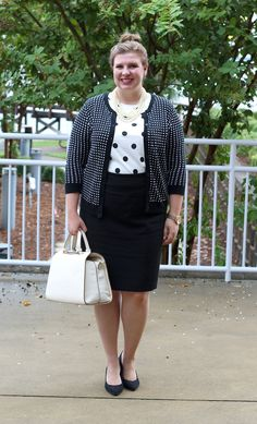 A lady-like outfit with black, white and lots of polka dots.