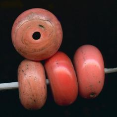 Old Sherpa glass coral beads. | Sherpa coral has been used for centuries in jewelry as a substitute for real coral. by the Sherpa people who inhabit the region around the Himalayan mountain range. |  Often classified as Trade Beads.