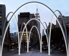 Flatiron Sky-Line: Hammocks suspended from over-sized illuminated arches invite you to experience the Flatiron District from a new angle this holiday season | Inhabitat New York City