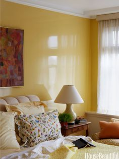 I like the yellow walls with the red and orange etc, and the cream/light yellow linen - 25 Bedroom Paint Colors - Ideas for Bedroom Color Schemes - House Beautiful Home Bedroom, Bedroom Wall, Bedroom Decor, Master Bedroom, Bedrooms, Bedroom Paint Colors, Bedroom Color Schemes, Interior Exterior, Interior Design