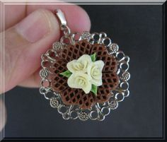 A beautiful chocolate pendant decorated with yellow roses in the middle.  Material : Polymer clay