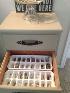 Place ice cube trays inside of a drawer to store and organize small items like jewelry, crafts supplies, and other little things that are easy to get mixed up or lost.