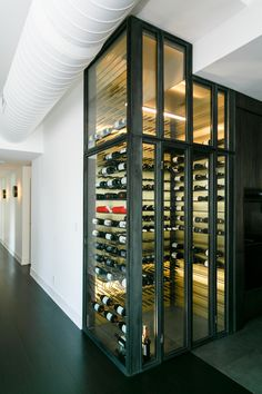 Custom designed and built wine cabinet.this was built in NYC apartment off of the kitchen.bronze and brass w custom metal shelving and pegs.led lighting and climate controlled Glass Wine Cellar, Wine Cellar Design, Wine Glass, Metal Shelves, Shelving, Just Wine, Bronze Kitchen, Wine Bottle Art, Wine Collection