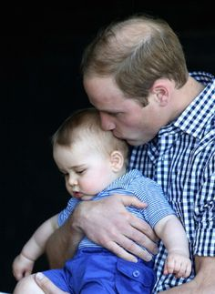 Father and son moment....Prince William, holds Prince George as they look at a Bilby called George at Taronga Zoo in Sydney, Australia, 20th  April 2014