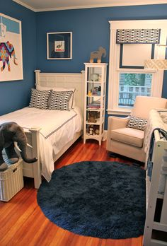 I like this room for its simplicity, placement of furniture & overall feel. It seems smaller than the boys room, but they managed to fit a lot of items in without overcrowding.