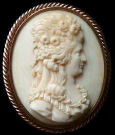 Queen Marie Antoinette      Ivory, gold plated brass (or 9ct gold).  Date and origin: France, ca 1880