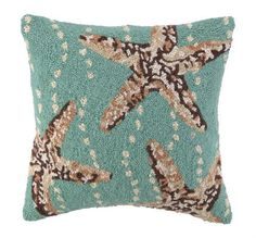 The Starfish Trio Aqua Hooked Beach House Pillow is a beach house pillow in off-white, driftwood grey and tan forming a trio of starfish images that will add gorgeous shades of coastal colors to your room!