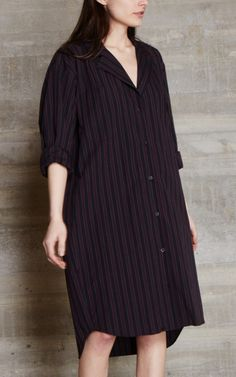 Button front shirt dress in a stripe cotton with a notched lapel. Long sleeves with pleated single button cuffs. Patch pocket at chest. Side seam hip pockets. Seamed back yoke. Knee-length. Slightly oversized fit. #rachelcomey