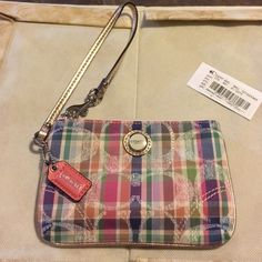 Coach Wristlet Coach Wristlet, new, tag in pocket. Had it safe in a fabric covered bin. See photos. Coach Bags Clutches & Wristlets