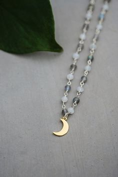 Any orders placed between May 11 and May 31 will be shipped on June 1st! For the minimalist who's not afraid to mix metals. A tiny crescent moon gold plated pendant set on an adjustable moonstone, lab