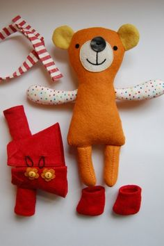 How to make your own toys - The book is a illustrated instruction manual that shows kids how to make soft toy animals. It includes templates, step-by-step directions, all the materials and ideas for embellishing finished stuffed animals. The striped scarf and red boots for the teddy bear (shown) are darling.