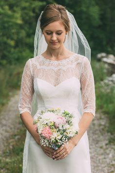 Real wedding in Finland. Dress made by Pukuni (www.pukuni.fi). Wedding dress with lace and open back. Sleeves and lace train.