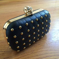 Loving this edgy clutch- make sure to snag it before it's gone!