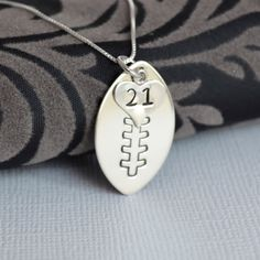 Hand-Stamped Football Necklace with Heart Charm stamped with Number- Football Mom Necklace. $39.00, via Etsy.