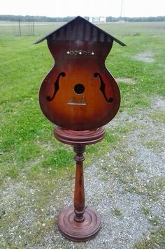 Repurposed guitar birdhouse sold exclusively at 231 Auction House and Relics, Jasper, In. by artist T.P.