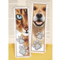 "Cat and Dog Bookmarks  MARK WHERE YOU ""PAWS"" with our pet-lovers' bookmarks! Counted cross stitch kit includes 14-count white Aida cloth, presorted DMC cotton floss, needle, chart and directions. Set of two, each 2 1/2"" x 8"". Imported from Belgium. A Stitchery exclusive!	      ****   Cat and Dog Bookmarks  Item #: T51679  Price: $18.99"
