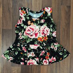 A personal favorite from my Etsy shop https://www.etsy.com/listing/599518611/black-floral-peplum-top-baby-peplum-top