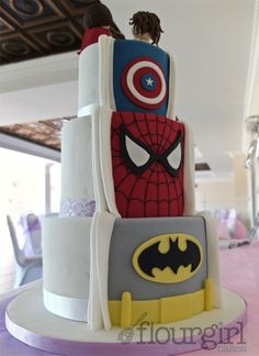 Secret Superhero Wedding Cake. Secret Superhero Cake. Spiderman Wedding Cake. Batman Wedding Cake. Captain America Wedding Cake. Half-and-half wedding Cake.