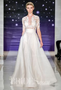 A cut-out @reemacra wedding dress with 3/4 sleeves | Brides.com