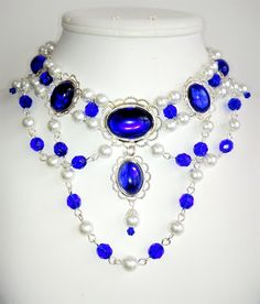 This hand-crafted, professionally made jeweled necklace was created based on the jewelry worn by royalty and the landed gentry of the Medieval and Renaissance Eras. It will add that finishing touch to any noblewomans attire. 18 by 13 mm and 18 by 25 mm Silver Plated Brass Lacy Filigrees set with Vintage Glass and Acrylic Cabochons  8 mm Imported Czech Glass Pearls  8 mm Imported Czech Glass Faceted Beads  4 mm Swarovsi Crystal Beads  Silver Plated Findings  @16 inches plus a 3 inch extender…