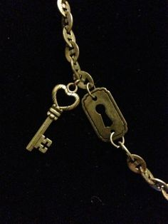 short antique silver skeleton key and key hole necklace.  By Renewed Root.