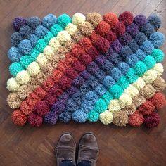 Rainbow pompom rug