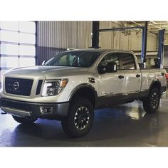 """Media CALMINI Products Inc. ( @calminiproducts )Customer picture of the CALMINI 2"""" Leveling Kit installed on a Titan XD. #calmini #calminiproducts #nissan #tita..."""