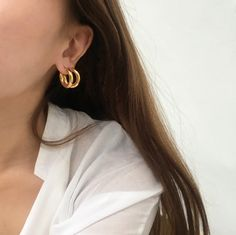 Love the layered hoops look! Pictured are the Rei in Bold Medium. Vintage Gold hoop earrings by www.thehexad.com