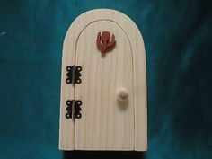 This sweet fairy door  kit comes with a thistle decoration, 2 hinges and screws and a door handle, it is made of pine and padauk. You can paint it, stain it or do decoupage to make it your own It was created by scroll saw artist Joanne MacKenzie