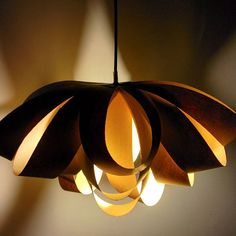 DIY Lamp:  See how you can make a giant decorative paper bow and turn it into an awesome pendant lamp