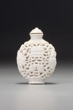 A reticulated white porcelain 'ba jixiang' snuff bottle Probably Imperial