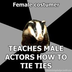 """""""Backstage Badger"""" Female costumer, teaches male actors how to tie ties."""