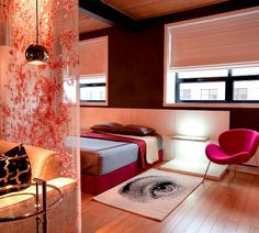 I don't care for the rug, but the rest of it is cool, esp. the room divider and the pink chair!