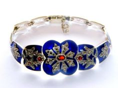 Art Deco Enamel Vintage Bracelet SS,Garnet and Marcasite Museum Collections. $245.00. Museum quality jewelry collection offered from limited quantity.. Collectors item.. Set in gem quality garnet and marcasite.. Art Deco Vintage Faberge Enamel Cuff Bracelet.. Magnifiscent detailed workmanship.