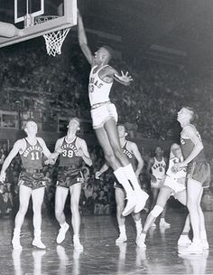 Wilt Chamberlain, University of Kansas...notice all the other players, earthbound, mouths agape!