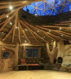 From FB page-->>   Cordwood Construction  A dramatic interior photo of a log framework, with a reciprocal roof (domed skylight) and thick thatching. The effect of the multiple use of natural materials is pleasing and amazing. This picture came from the FB page of La Biogula.