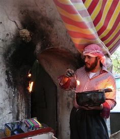 An Iraqi Yazidi man lights candles near the holy Lalish temple in the Mountains of Shikhan near Dahuk. Source: AP photo. The Yazidis are one of the world's smallest and oldest monotheistic religious minorities.