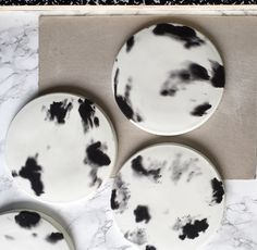 A versatile black and white circle plate made of concrete with a cork bottom to protect any surfaces. The plate can be used as a type of coaster to protect surfaced | pillar candles | jewellery | salt   pepper grinders | vase | decorative piece. Each plate is hand crafted so each one is unique and will have a different pattern. Size; H:1cm  W:14.5cmPLEASE NOTE: This item is not food safe!*Please allow 3-5 working days for your item to be made and dispatched.. Thank you...