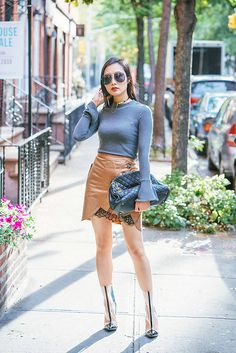 Get this look: http://lb.nu/look/8848869  More looks by Tina Lee: http://lb.nu/ofleatherandlace  Items in this look:  Get Back To Square One Mock Neck Sweater, Eddie Borgo Choker, Quay Needing Fame Sunglasses, Self Portrait Utility Skirt, Kendall + Kylie Pvc Boots   #chic #elegant #street #sale #shopbop #shopbopsale #ootd #selfportrait #streetstyle