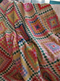 Antique hand stitched and hand quilted postage stamp quilt 85 x 87, seen on eBay at bgrboots