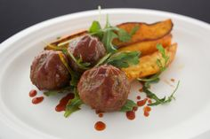 Delicious Grassfed Bison Meatballs paired with Green Apple Slaw and Arugula Salad
