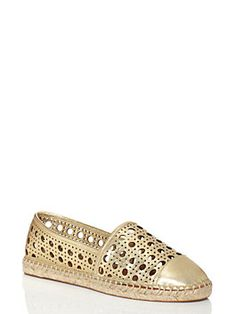 quite possibly the ultimate shoe for a sunny saturday afternoon, the leonia pairs the sole (and the soul) of an espadrille with a perforated gold leather upper, for a look that's both easy and chic.