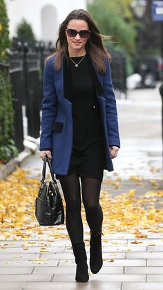 We're slightly obsessed with Pippa's blueSara Berman coat with suede trim which she wore with a black dress and booties. via @stylelist