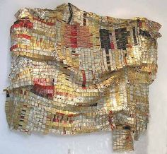 "El Anatsui __ photo by ""Tribal Trappings"" blogger at the National Museum of African Art (Smithsonian). Large ""cloth"" made of metal strips from the necks & tops of liquor bottles. ""The rich metallic color brings to mind Ghana's famous goldsmith traditions... its composition of strips gives a nod to the strip-woven cloth of Ghana, called 'kente.'"" _ El Anatsui was born in Ghana, but lives & teaches in Nigeria since 1975."