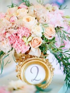 Vintage gold framed table number and pink flowers wedding centerpiece