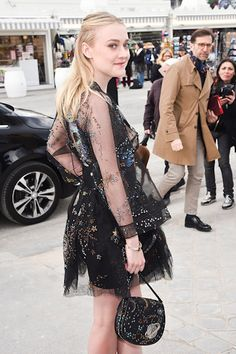 Dakota Fanning in Valentino attended the Valentino Fall 2016 show during Paris Fashion Week on March 8, 2016