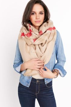 We are up to our necks in love with this blanket scarf! Not only will it keep you hot in every sense of the word, but it goes well with practically everything