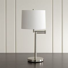 Brushed Nickel Swing Arm Table Lamp.  These are the lamps we have for our bedside tables.