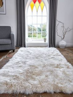 This large long wool champagne sheepskin rug creates a rustic or modern style depending on the chosen decor!