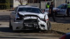 The collision, which involved a police car, happened just after 1:00 P.M. Thursday.